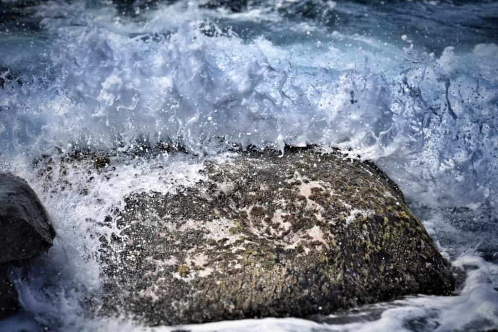 Waves Breaking Over Rock
